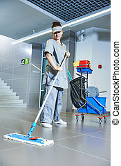 worker cleaning floor with machine - Floor care and cleaning...