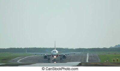 Aiplane taxiing - Airbus 320 taxiing by runway after landing...