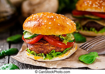 Vegetarian burger with grilled champignon, tomato and...