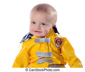 Proud Baby Fireman - Closeup of an adorable baby boy wearing...