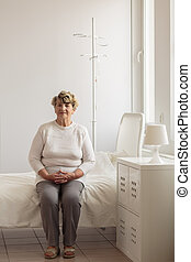 Senior sitting on the bed - Female senior sitting on the bed...