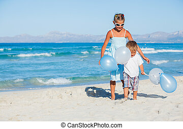 Kids with ballons on the beach