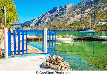 Small port with boat and blue gate, Greece - View of small...