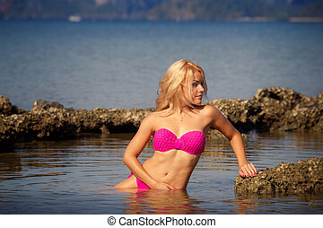 blonde in swimsuit side-view half in sea - blonde longhaired...