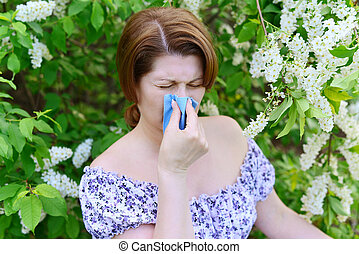 woman with allergic rhinitis about bird cherry blossoms - A...