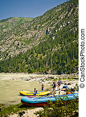 Rafting - Raft with a tourists on a bank of Katun river