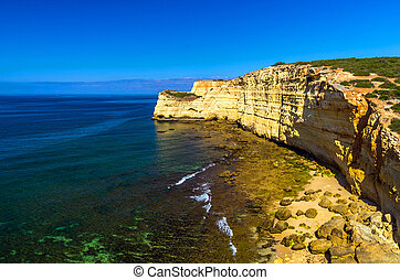 beaches in the Algarve - High rocky coastline with beaches...