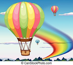 Balloons and rainbow - Balloons flying in the sky with...