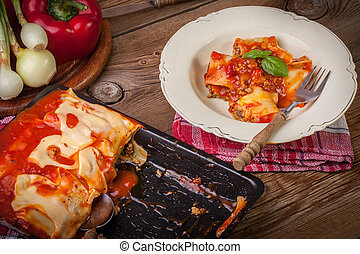 Lasagna with beef Italian cuisine - Cannelloni with minced...