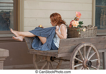 Women in old cart - Adult sexy women with apple in hand...