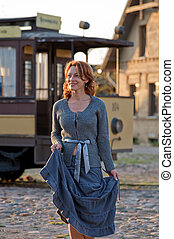 Women and retro tram - Smiling adult women and retro tram in...