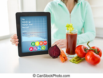 close up of woman with tablet pc and vegetables - healthy...