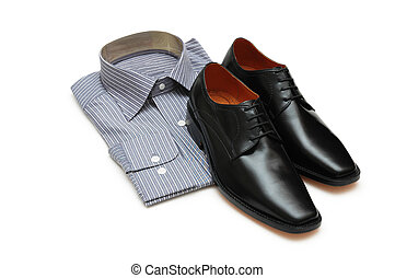 Pair of black shoes and new shirt isolated on white - Pair...