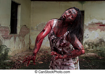 Zombie girl in haunted house scary