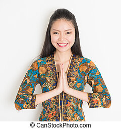 Asian girl greeting - Portrait of happy Southeast Asian...