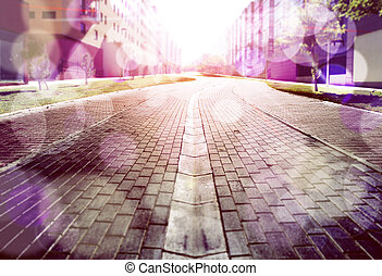 Abstract street floor background.Cobbled floor and sunbeams