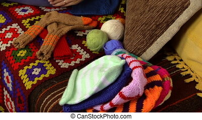 grandma knit baby sock - panning view of young pregnant...