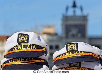 hat for sailors with VENICE written and the ClockTower two bronze statues