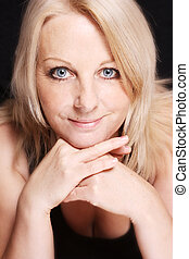 Close up of a middle aged woman - A close up of a pretty...
