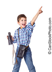 Boy standing with spyglass and pointing - Smiling boy...