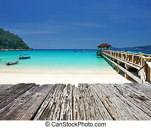 Beautiful beach and old wooden pier at Perhentian islands,...