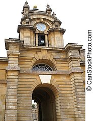 Blenheim Palace, Woodstock, UK - clock tower of an arched...