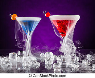 Martini drinks with dry ice smoke effect, served on bar...