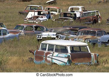 scrapyard - abandoned cars in a meadow