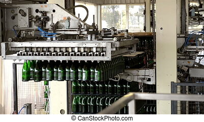 Bottles being prepared for liquid in the machine