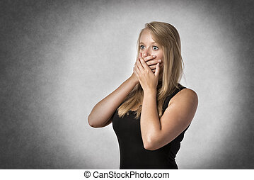 Blond anxiously woman - Blonde shocked woman holding...