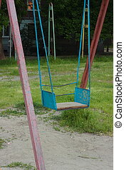 teeter - the street is an old children's swing