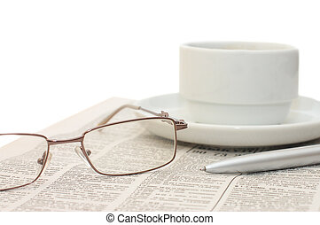 Cup from coffee on the newspaper