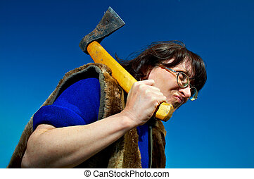 woman with axe - sullen woman with axe on blue background
