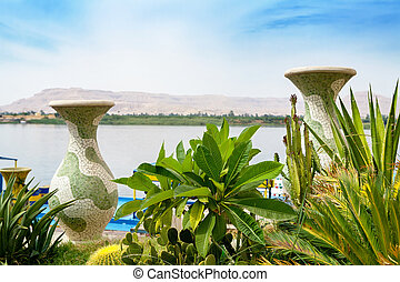 Nile River at Luxor. Egypt - Vases and plants on the banks...