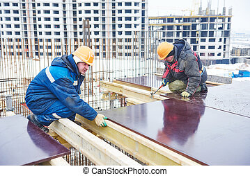 construction building site workers - concrete work: workers...