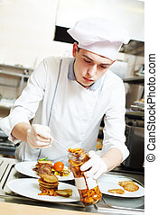 cook chef with food in kitchen