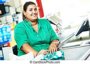 Shopping. Cashdesk cashier worker in supermarket - Portrait...