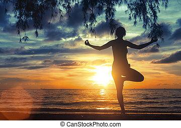 Silhouette of girl meditating