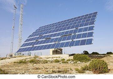Solar energy - solar panel with blue sky and...