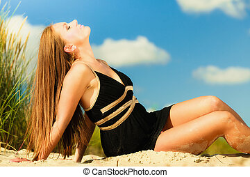Woman sunbathing on beach - Summer vacation day freetime...