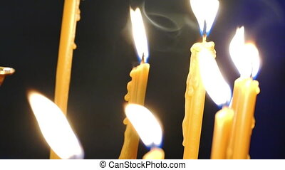 Burning flame of candles in church - Candles burning during...