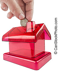 red house shaped piggy - red piggy-shaped house with a hand...