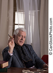 Man smoking cigar - Senior rich elegant man smoking cigar...