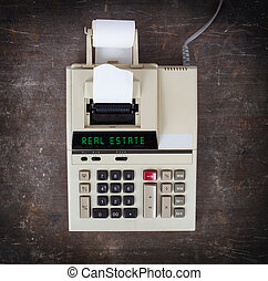 Old calculator - real estate - Old calculator showing a text...