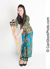 Ramadan female - Full body portrait of Southeast Asian woman...