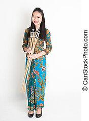 Woman Celebrate Ramadan - Full body portrait of Southeast...