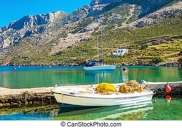 Small white boat with fish nets , Greece