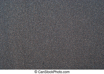 Sand texture or backround. Wet black volcanic sand from...