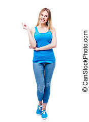 Full length portrait of a cheerful beautiful woman isolated...