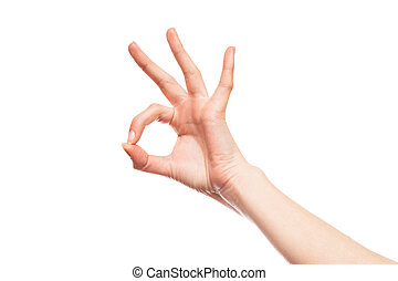 Okey sign - Isolated woman's hand showing ok sign on plain...